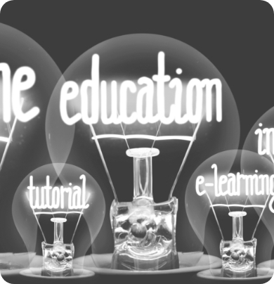 Black and white lightbulbs with tutorial, education and e-learning lettering